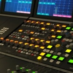 Image of a mixing desk in a recording studio